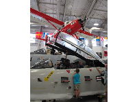 A boy checks out a plane in the second hangar.