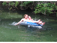 Enjoying a leisurely drift down the spring run in a rubber raft.