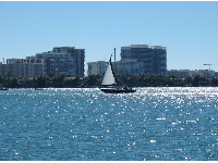 Looking out at Bal Harbour and a sailboat from the pier.