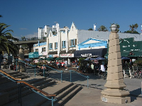 "Cafes alongside the pier, including the famous ""Muscle In"" Cafe."