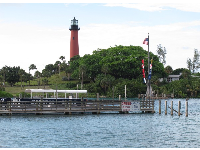 View of the lighthouse and manatee queen boat from Jetty's.