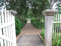 The gate that leads from the house to the garden.