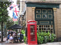 Sidewalk cafe and British telephone booth.
