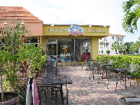 Frozen custard shop with outdoor seating.