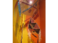 Haitian kites with fringed edges that make a pleasing sound in the wind.