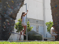 Tightrope walking by the rock-climbing walls.