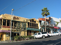 Little stores and restaurants slope down to the sea, at Manhattan Beach.