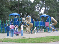 The playground, with huge winding slides, backed by plenty of wonderful trees, near the Waller Lane entrance.