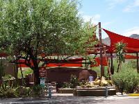 Red shade canopies over cactus gardens.