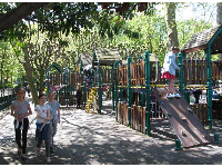 Girls hanging out by the wooden-style playground