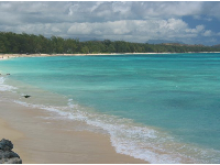 The stunning waters, near the orange-pink house at the south end of Waimanalo Beach.