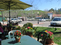 The sunny patio with mountain views, at New Frontiers natural marketplace.