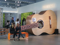 A giant guitar that kids can strum and walk inside.
