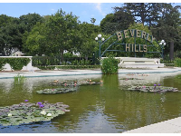 Water lilies and Beverly Hills sign in Beverly Gardens Park.