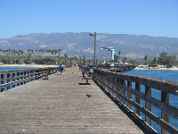 The end of the pier, looking back toward the mountains and beach.