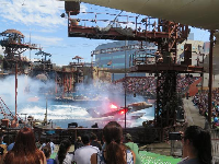 An airplane lands on the water in the Waterworld show.