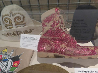 Red glittered desert boots, sent to Chief Pierce by SW1 English in the last care package before returning home.