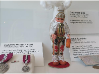 Italian currency and costumed doll from Belgium.