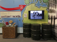 Exhibit about Operation Torch (North Africa), Operation Husky (Sicily), and Operation Avalanche (Italy).