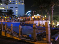 FlowRider, or surf simulator, outside the Margaritaville Hollywood Beach Resort on the boardwalk.