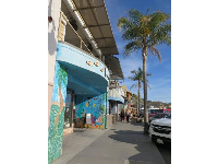 Ocean-themed shop exterior on Front Street.