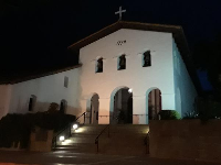 The mission at night.