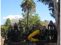 The playground with its towers, and plenty of diverse trees.
