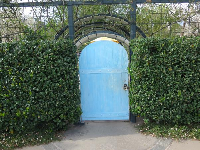 Turquoise door in the children's garden beckons you to enter.