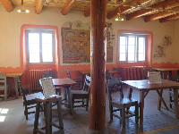 Inside Painted Desert Inn, with its log columns.