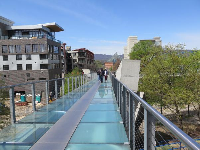 Glass pedestrian bridge that leads up to the museum.