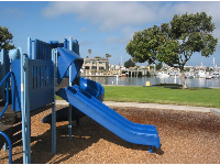 Playground with harbor in the background.