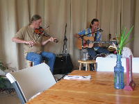 Richard Johnston and his friend playing at the cafe.