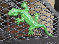 Fence with gecko decoration.