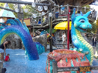 Sea monster splash pad in Land of the Dragons play area.
