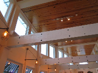 Cool lighting, lots of light, and beautiful wood beams.