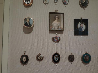 Miniature portraits of loved ones, worn in vest pockets or chained to men's pocket watches, or worn by women as bracelets, brooches, or lockets