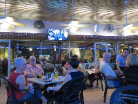 Outdoor seating at Hollerbach's on New Year's Eve, with the European countdown on the screen overhead.