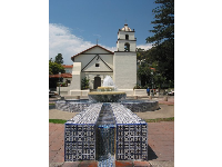 A tiled stream of water leads down far to another fountain...