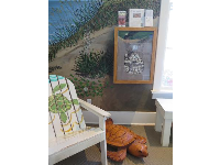 Kids area with turtle nest display.