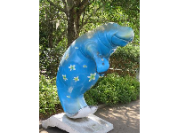 Manatee sculpture in bright blue- sweet.