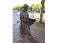 "Statue, in Ellis Square, of Johnny Mercer, composer of nearly 1200 songs, including ""Moon River."" He co-founded Capitol Records and won four Oscars."