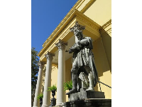 Statue of Michaelangelo outside Telfair Museum building.
