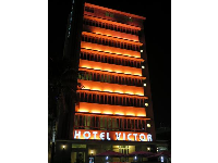 Hotel Victor and its neon lights.