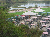 The tables outside Campus Center, overlooking the lagoon.