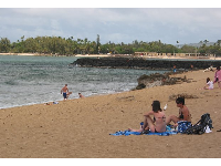 Hanging out at Haleiwa Alii Beach- see the jetty for Haleiwa Harbor in the background.