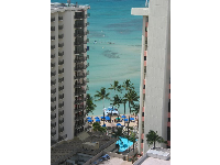 View of the aquamarine waters of Royal Hawaiian Beach, as seen from the Holiday Inn Waikiki Beachcomber Resort.