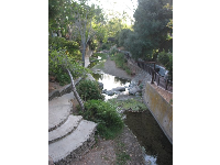 Looking way down to the creek between Higuera Street and the mission.