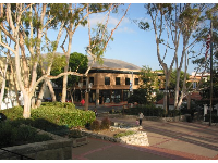 The spacious plaza in front of the mission, and the historic buildings on Chorro St.