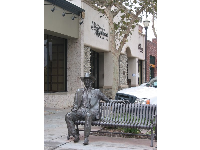 Bench with statue in Old Town Camarillo.