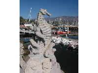 Statue of boy riding a sea horse, at the harbor.